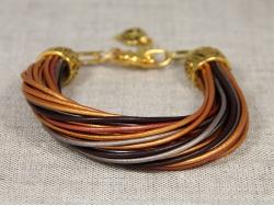 Браслет из золотых тонких кожаных шнуров от Marina Lurye